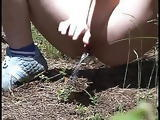 busty blonde teen pissing in forest
