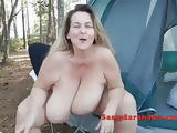 Sassy Sarah parades her tits naked in the woods